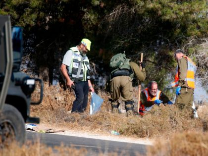 Israeli soldiers and forensic experts inspect the scene where the body of an Israeli soldier was found with multiple stabs near the settlement of Migdal Oz in the occupied West Bank on August 8, 2019. - An Israeli soldier's body was found with multiple stab wounds near a Jewish settlement …