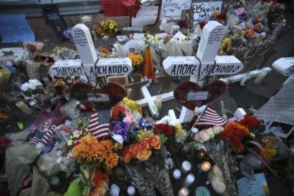 Authorities seek leads in mass shootings that left 31 dead