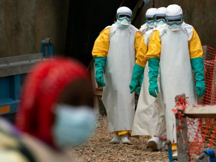 In this Tuesday, July 16, 2019 photo, health workers dressed in protective gear begin their shift at an Ebola treatment center in Beni, Congo DRC. The World Health Organization has declared the Ebola outbreak an international emergency after spreading to eastern Congo's biggest city, Goma, this week. More than 1,600 …
