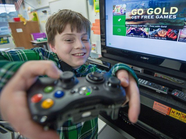 young boy playing Xbox