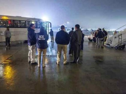 ICE ERO officers prepare to board a group of migrants on a charter removal flight. (File Photo: U.S. Immigration and Customs Enforcement/Enforcement and Removal Operations)