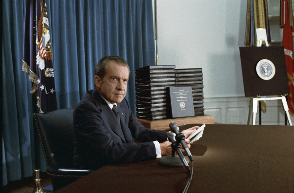 President Nixon with his edited transcripts of the White House Tapes subpoenaed by the Special Prosecutor, during his speech to the Nation on Watergate