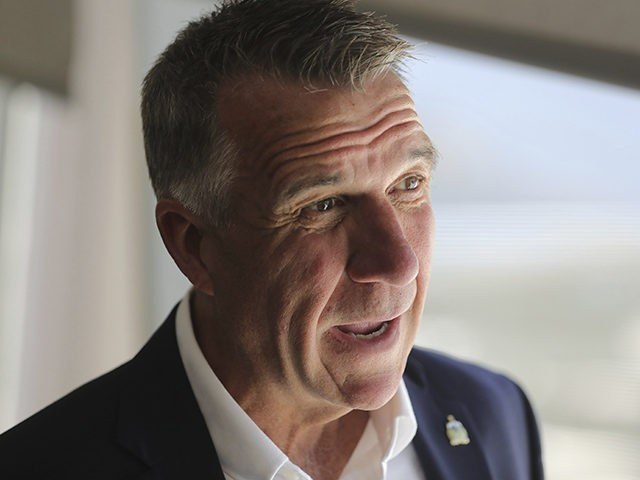 Vermont Gov. Phil Scott to a reporter before a news conference launching a Outdoors Recreation Initiative Wednesday, July 24, 2019, in Salt Lake City. Governors from about 25 states are gathering in Utah this week for the summer conference of the National Governors Association. The state leaders are expected to …