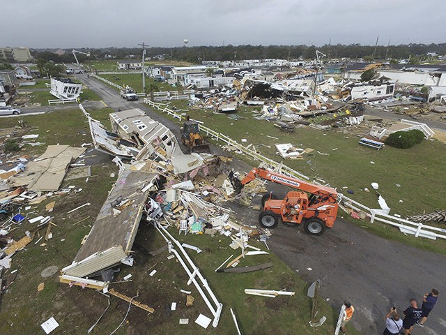CORRECTS YEAR TO 2019-Emerald Isle town employees work to clear the road after a tornado hit Emerald Isle N.C. as Hurricane Dorian moved up the East coast on Thursday, Sept. 5, 2019. (AP Photo/Tom Copeland)