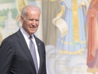 "U.S. Vice President Joe Biden walks near St. Michael's Cathedral in Kiev, Ukraine, Tuesday, April. 22, 2014. Biden warned Russia on Tuesday that ""it's time to stop talking and start acting"" to reduce tension in Ukraine, offering a show of support for the besieged nation as an international agreement aimed …"