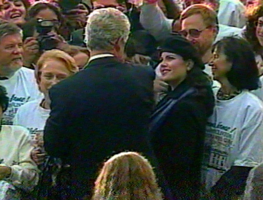 In this image taken from video, Monica Lewinsky (wearing beret) watches President Clinton as he greets White House staff members on the South Lawn of the White House on Nov. 6, 1996, during a victory celebration after his re-election. (AP Photo/APTV)