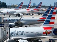 In this April 24, 2019, photo, American Airlines aircraft are shown parked at their gates at Miami International Airport in Miami. An American Airlines mechanic is accused of sabotaging a flight from Miami International Airport to Nassau in the Bahamas, over stalled union contract negotiations. Citing a criminal complaint affidavit …