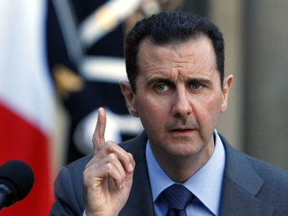 Syria President Bashar al-Assad addresses reporters following his meeting with French President Nicolas Sarkozy at the Elysee Palace in Paris, Thursday Dec. 9, 2010. (AP Photo/Remy de la Mauviniere)