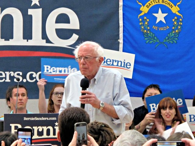"""Sen. Bernie Sanders, I-Vt., speaks to several hundred people while campaigning for president at a town hall meeting at the Carson City Convention Center, Friday, Sept. 13, 2019, in Carson City, Nev. He said former Vice President Joe Biden is distorting Sanders' """"Medicare for All"""" health care plan. (AP Photo/Scott …"""