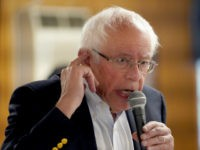 Democratic presidential candidate Sen. Bernie Sanders, I-Vt talks about the inclusion of hearing care in his Medicare for all plan as he campaigns at the Circle 9 Ranch Campground Bingo Hall, Tuesday, Sept. 3, 2019, in Epsom, N.H. (AP Photo/Mary Schwalm)