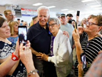 Democratic presidential candidate former Vice President Joe Biden gets a hug from Ruth Nowadzky, of Cedar Rapids, Iowa, during the Hawkeye Area Labor Council Labor Day Picnic, Monday, Sept. 2, 2019, in Cedar Rapids, Iowa. (AP Photo/Charlie Neibergall)