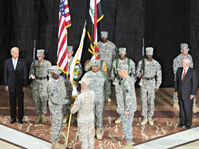Centcom Commander General James Mattis (C) hands over the flag of the Multi-National Force Iraq to incoming commander Lieutenant General Lloyd Austin (front L) as outgoing commander General Ray Odierno (R) looks on during a Change of Command ceremony at Camp Victory in Baghdad on September 01, 2010, as US …