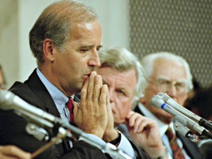 Senate Judiciary Committee chairman Joseph Biden, D-Del., reflects on the testimony of University of Oklahoma law professor Anita Hill before the committee to nominate Clarence Thomas to the Supreme Court, on Capitol Hill in Washington, Oct. 12, 1991. Thomas has categorically denied hill's allegations of sexual harassment and told the …