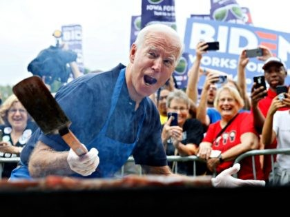 Democratic presidential candidate former Vice President Joe Biden works the grill during the Polk County Democrats Steak Fry, Saturday, Sept. 21, 2019, in Des Moines, Iowa. (AP Photo/Charlie Neibergall)