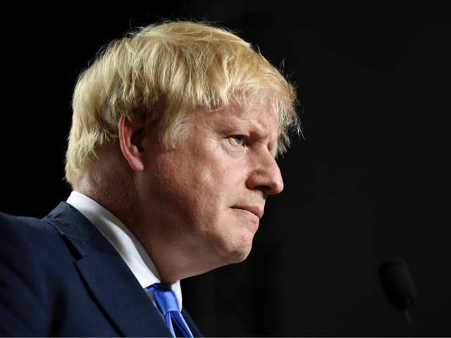 BIARRITZ, FRANCE - AUGUST 24: British Prime Minister Boris Johnson during a press conference in the Bellevue hotel conference room at the conclusion of the G7 summit on August 24, 2019 in Biarritz, France. The French southwestern seaside resort of Biarritz is hosting the 45th G7 summit from August 24 …
