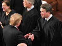 US President Donald Trump shakes hands with US Supreme Court Justice Brett Kavanaugh before delivering the State of the Union address at the US Capitol in Washington, DC, on February 5, 2019. (Photo by MANDEL NGAN / AFP) (Photo credit should read MANDEL NGAN/AFP/Getty Images)