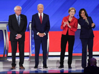 Democratic presidential hopefuls (L-R) Mayor of South Bend, Indiana, Pete Buttigieg, Vermont Senator Bernie Sanders, Former Vice President Joe Biden, Massachusetts Senator Elizabeth Warren and California Senator Kamala Harris arrive on stage for the third Democratic primary debate of the 2020 presidential campaign season hosted by ABC News in partnership …