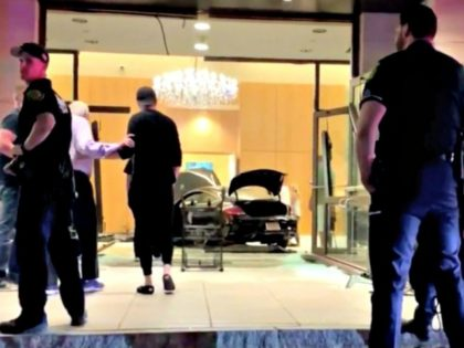 Car Crashes into Trump Hotel