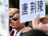 Blind Chinese activist Chen Guangcheng (C) together with relatives of political prisoners held in China takes part in a protest outside the Capitol in Washington DC on September 17, 2014. The daughters and relatives of political prisoners held in China made an appeal to Beijing to let their fathers and …