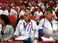 Some 100 Cuban doctors follow proceedings during their induction programme at the Kenya School of Government, on June 11, 2018 in Nairobi. - The doctors will be posted to various hospitals in Kenya's 47 counties. Each county is expected to get at least two doctors. (Photo by SIMON MAINA / …