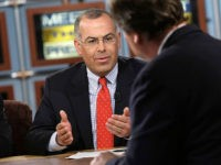 "WASHINGTON - APRIL 20: New York Times columnist David Brooks (L) speaks as moderator Tim Russert (R) looks on during a taping of ""Meet the Press"" at the NBC studios April 20, 2008 in Washington, DC. Brooks discussed on the race between Democratic U.S. presidential hopefuls Sen. Barack Obama (D-IL) …"