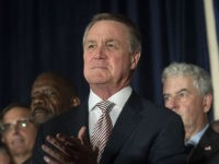 U.S. Senator David Perdue speaks during a Georgia Republican Party unity rally Thursday, July 26, 2018, in Peachtree Corners, Ga. The rally was held after a heated gubernatorial primary runoff race which pitted Lt. Governor Casey Cagle and Secretary of State Brian Kemp against each other with Kemp winning. (AP …