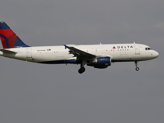 A Delta Airlines aircraft makes its approach at Dallas-Fort Worth International Airport in Grapevine, Texas, Monday, June 24, 2019. (AP Photo/Tony Gutierrez)