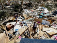 GREAT ABACO, BAHAMAS - SEPTEMBER 5: Two women look for lost items after Hurricane Dorian passed through in The Mudd area of Marsh Harbour on September 5, 2019 in Great Abaco Island, Bahamas. Hurricane Dorian hit the island chain as a category 5 storm battering them for two days before …