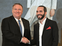 US Secretary of State Mike Pompeo shakes hands with Salvadorean President Nayib Bukele (R) after signing bilateral agreements at the presidential residence in San Salvador on July 21, 2019. (Photo by MARVIN RECINOS / AFP) (Photo credit should read MARVIN RECINOS/AFP/Getty Images)