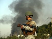 Smoke rises as angry Kabul residents set fire to part of the Green Village compound that has been attacked frequently, a day after a Taliban suicide attack in Kabul, Tuesday, Sept. 3, 2019. An interior ministry spokesman said some hundreds of foreigners were rescued after the attack targeted the compound, …