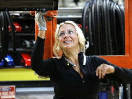 DEARBORN, MI - SEPTEMBER 27: Ford Motor Company worker Nikki Hughs works on a Ford F150 truck on the high-line at the Ford Dearborn Truck Plant on September 27, 2018 in Dearborn, Michigan. The Ford Rouge Plant is celebrating 100 years as America's longest continuously operating auto plant. The factory …