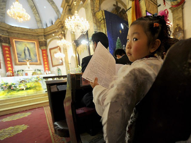 A young girl dressed as an angel attends the Christmas Eve mass at a Catholic church in Beijing on December 24, 2010. The Vatican and China have not had formal diplomatic ties since 1951, when the Holy See angered Mao Zedong's Communist government by recognising the Nationalist Chinese regime as …