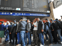 Tunisian would-be immigrants pose before boarding a train at Rome's Termini station to Ventimiglia, the Italian border town with France on April 21, 2011. Dozens out of the thousands who have fled from Tunisia to Italy by boat in recent weeks in the wake of the Jasmine Revolution in January …