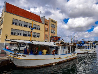 Venezuelan boats remains moored at a port in Willemstad, Curacao, Netherlands Antilles, on February 24, 2019. - In separate reports last year, Amnesty and Human Rights Watch criticized the Curacao authorities over their treatment of Venezuelan immigrants. It accused them of deporting migrants who may have a right to asylum …