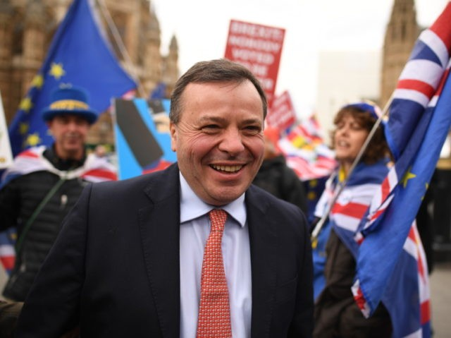 LONDON, ENGLAND - MARCH 27: Businessman and co-founder of the Leave.EU campaign, Arron Banks speaks with demonstrators outside the Houses of Parliament on March 27, 2019 in London, England. Today MPs will Vote on alternative plans for Brexit. (Photo by Leon Neal/Getty Images)