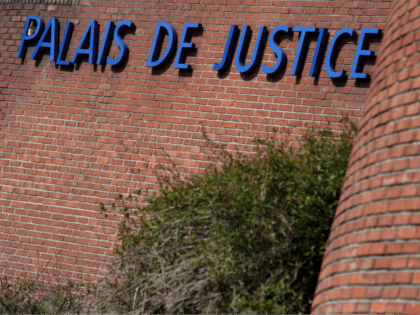 A picture taken on March 27, 2019 shows the lettering 'Palais de Justice' at the entrance to the courthouse of the Criminal Court of Bobigny near Paris. - Following a series of vigilante attacks near Paris against the Roma community, sparked by false reports of attempted kidnappings, police arrested 20 …