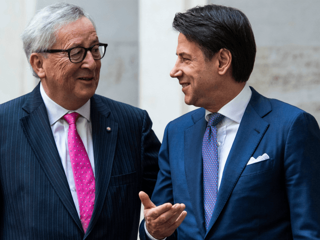 Italys Prime Minister Giuseppe Conte (R) greets President of the European Commission Jean-Claude Juncker upon his arrival for their meeting at Palazzo Chigi on April 2, 2019 in Rome. (Photo by Filippo MONTEFORTE / AFP) (Photo credit should read FILIPPO MONTEFORTE/AFP/Getty Images)