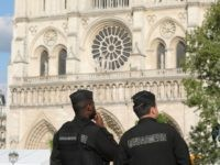 French gendarmes stand alert outside Notre-Dame de Paris Cathedral in Paris on April 29, 2019, two weeks after a fire ravaged the roof of the 850-year-old landmark. - Nearly two weeks later, a police cordon is still keeping members of the public well away from the site in the centre …