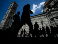 People walk outside the Santa Maria del Fiore Cathedral on June 18, 2019 in Florence. (Photo by Filippo MONTEFORTE / AFP) (Photo credit should read FILIPPO MONTEFORTE/AFP/Getty Images)