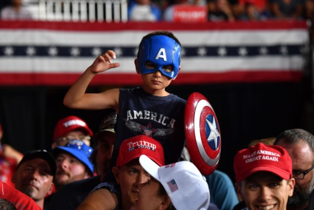 "TOPSHOT - Supporters of US President Donald Trump attend a ""Keep America Great"" campaign rally at the SNHU Arena in Manchester, New Hampshire, on August 15, 2019. (Photo by Nicholas Kamm / AFP) (Photo credit should read NICHOLAS KAMM/AFP/Getty Images)"