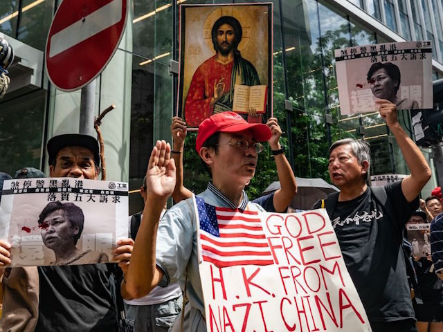 HONG KONG - AUGUST 31: Protesters take part in an anti-government rally as they march on a street in Central district on August 31, 2019 in Hong Kong, China. Pro-democracy protesters have continued rallies on the streets of Hong Kong against a controversial extradition bill since 9 June as the …