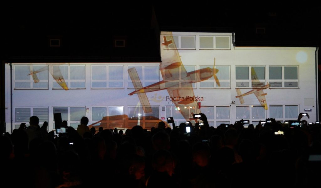 Residents of Wielun watch a screening off bombing the town on September 1, 1939 during a ceremony marking the 80th anniversary of the outbreak of the World War II, in Wielun on September 1, 2019. - German President Frank-Walter Steinmeier on September 1, 2019 asked Poland's forgiveness for history's bloodiest conflict during a ceremony in the Polish city of Wielun, where the first World War II bombs fell 80 years ago. (Photo by Alik KEPLICZ / AFP) (Photo credit should read ALIK KEPLICZ/AFP/Getty Images)