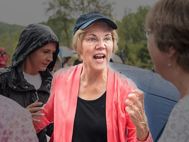 HAMPTON FALLS, NH - SEPTEMBER 02: Senator and Democratic presidential candidate Elizabeth Warren greets attendees in the rain after speaking at a Labor Day house party on September 2, 2019 in Hampton Falls, New Hampshire. (Photo by Scott Eisen/Getty Images)