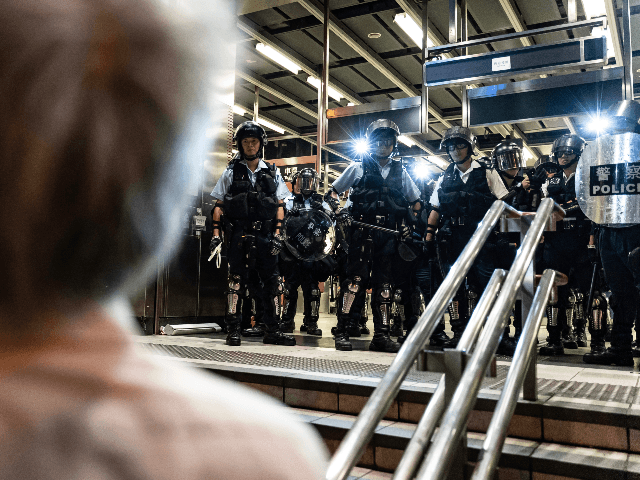Police officers stand guard at Po Lam Station during a standoff with protesters on September 5, 2019 in Hong Kong, China. Pro-democracy protesters have continued demonstrations across Hong Kong since 9 June against a controversial bill which allows extraditions to mainland China, as the ongoing protests, many ending up in …