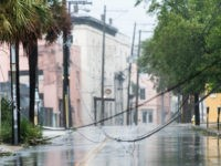 CHARLESTON, SC - SEPTEMBER 5: Downed utility lines block a street as Hurricane Dorian spins just off shore on September 5, 2019 in Charleston, South Carolina. Hurricane Dorian is now at Category 2 strength as it makes its way up the U.S. East Coast, unleashing flooding, high winds and tornadoes, …