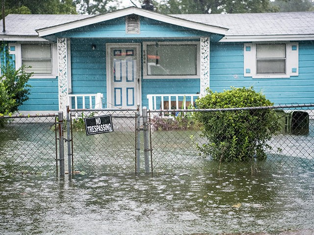 GEORGETOWN, SC - SEPTEMBER 5: Flood water accumulates in the front yard of a home on September 5, 2019 in Georgetown, South Carolina. Hurricane Dorian spins just off shore of the state and is forecasted to brush along the Outer Banks in North Carolina tomorrow morning. (Photo by Sean Rayford/Getty …