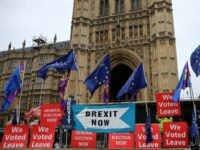 "Pro-Brexit protesters stand with ""We Voted Leave"" placards among signs calling for ""Brexit Now"" and EU flags outside the Houses of Parliament in London on September 9, 2019. - British Prime Minister Boris Johnson met his Irish counterpart in Dublin on Monday as he battles to salvage his hardline Brexit …"