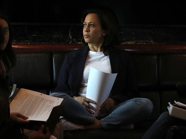 "SIOUX CITY, IOWA - AUGUST 09: Democratic presidential hopeful U.S. Sen. Kamala Harris (C) (D-CA) rides on her campaign bus to a campaign event in Storm Lake on August 09, 2019 in Sioux City, Iowa. Kamala Harris is on a five day river-to-river bus tour across Iowa promoting her ""3AM …"