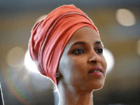 US Representative Ilhan Omar arrives for the Congressional Black Caucus (CBC) ceremony to commemorate the 400th anniversary of the first recorded forced arrival of enslaved Africans in the Emancipation Hall of the US Capitol in Washington, DC on September 10, 2019. (Photo by MANDEL NGAN / AFP) (Photo credit should …