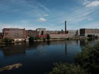 LAWRENCE, MASSACHUSETTS - AUGUST 16: Old factories sit along the river in Lawrence on August 16, 2019 in Lawrence, Massachusetts. Lawrence, once one of America's great manufacturing cities with immigrants from around the world coming to work in its textile and wool processing mills, has struggled to find its economic …